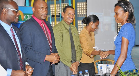Multi Sportswoman of the Year Levern Spencer (r) greeting the head table at the recent launch of the  013-2014 School Sports Program.