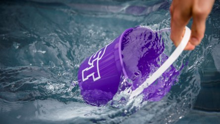 221 people filled purple buckets with ice water from giant tubs on the John P. Monahan Plaza. (Photo by Mike Ekern '02)
