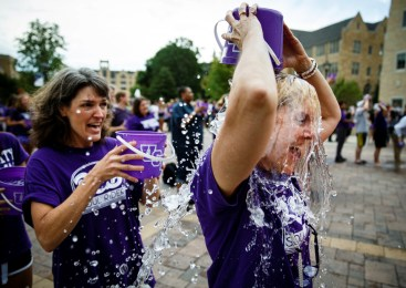 College of Education, Leadership and Counseling professor Terri Vandercook douses herself with cold water. UST's ice bucket challenge was done in honor of former CELC dean Bruce Kramer, who has ALS. (Photo by Mike Ekern '02)