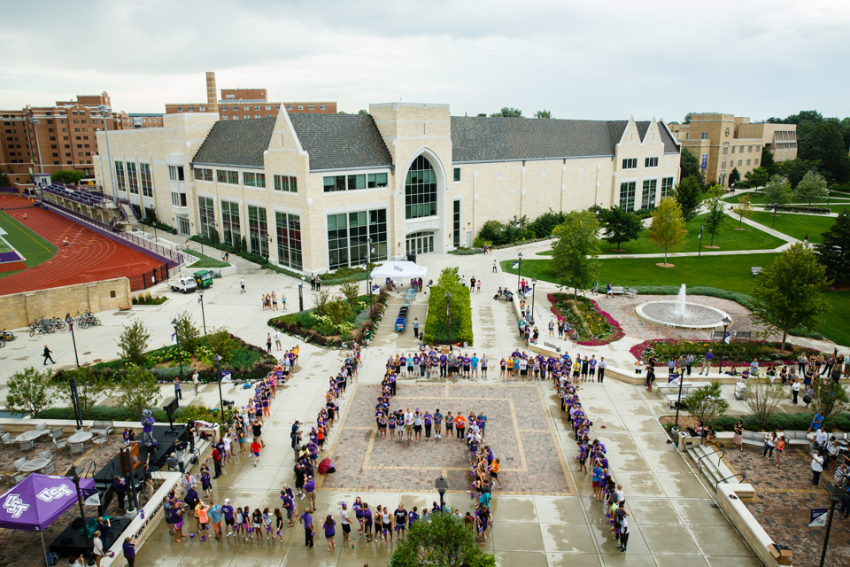 """Students, faculty and staff arranged themselves in the shape of a giant """"UST"""" before pouring cold water over their heads. (Photo by Mark Brown)"""