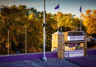 A quiet O'Shaughnessy Stadium backed by fall leaves. (Photo by Mike Ekern '02)