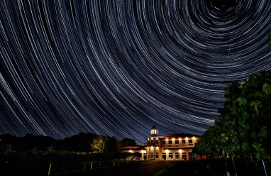 Stars paint trails of light in the sky over the Winehaven Winery and Vineyard in Chisago City, Minnesota. Winehaven is owned by alum Kyle Peterson. Look for more coverage of Peterson and other wine-making alums in the Winter 2015 issue of St. Thomas magazine.