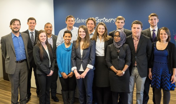 From left: Alec Johnson, Bobby Mason, Hannah Detra, Isaac Onsomu, Nicole Naidoo, Ryan Kruizenga, Kara Gamelin, Mike Schmitt, Kate Segrin, Muna Khalif, Connor Koerbitz, Justin Thunstrom, Lucas Gaughan, and Nicole Matter at the Mainsail offices in downtown San Francisco.