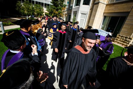 Communication and Journalism faculty member John Keston participates in a procession at the start of the President's Academic Convocation in Minneapolis.