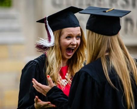 Alyssa Adkins shrieks with excitement during commencement.