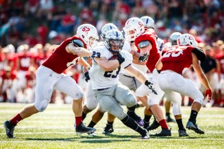 Running back Jordan Roberts rushes against Saint John's.