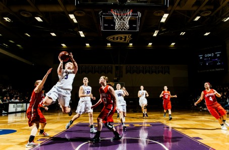 Katie Stone drives to the basket during the 2016 women's basketball MIAC Championship game.