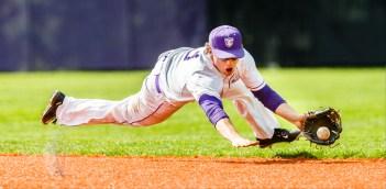 Zach Gottfredsen dives for a ball.