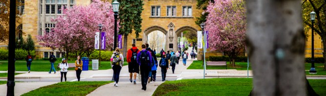Students walk past the Arches.