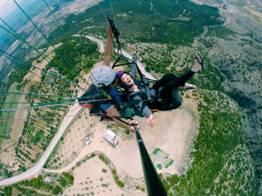 "Second place, Most Epic Selfie: Mary Naughton, Southern Turkey. ""No Insurance Forms Needed: This photo was taken while paragliding over the Pamukkale thermal baths in southern Turkey. I asked the gentleman if my flip-flops were an issue and his response was that my helmet was optional."""