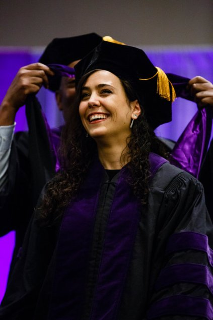 A student smiles as she is hooded during the School of Law Commencement ceremony May 13, 2017 at the Minneapolis Hilton.