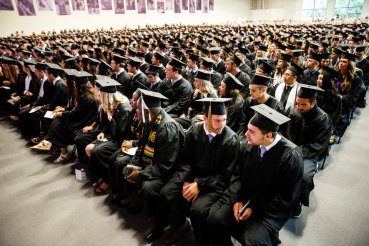 Student await the start of the 2017 Undergraduate Commencement ceremony in the Anderson Athletic and Recreation Complex in St. Paul on May 20, 2017.