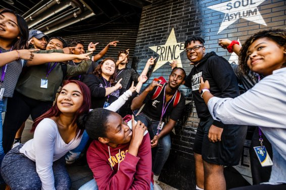 Dougherty Family College Students point to the star for the artist Prince on the wall of the First Avenue music venue August 23, 2017 in Minneapolis.