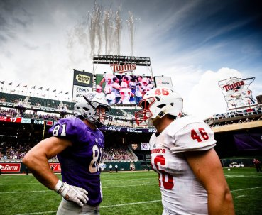 Grant Slavik (81) stands with Saint John's player Trevor Dittberner following the Tommie Johnnie football game at Target Field in Minneapolis on September 23, 2017. The University of St. Thomas defeated Saint John's University by a final score of 20-17.