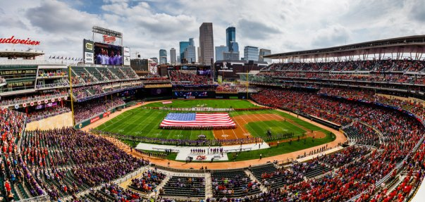 A large American flag fills the field during the national anthem at the Tommie Johnnie football game at Target Field in Minneapolis on September 23, 2017. The University of St. Thomas defeated Saint John's University by a final score of 20-17.