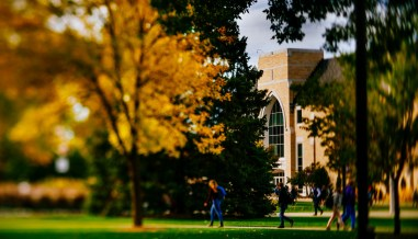 The Anderson Athletic and Recreation Complex stands amid fall trees.