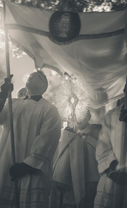 Msgr. Aloysius Callaghan carries a monstrance with the eucharist down Summit Avenue during the Borromeo Weekend procession November 3, 2017. The procession, between the Chapel of St. Thomas Aquinas and St. Mary's Chapel, kicks off 40 hours of prayer and eucharistic adoration to celebrate Saint Charles Borromeo, the patron saint of seminarians.