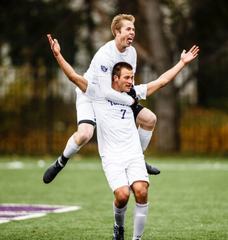 Christian Elliehausen celebrates a goal with teammate Pierce Erickson on his back during the MIAC Championship soccer game against Macalester.