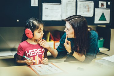 Alum Courtney Hauboldt works with a student in her class at Highland Elementary School. Look for a story about Hauboldt's work with autistic students in the Winter 2018 issue of St. Thomas magazine.