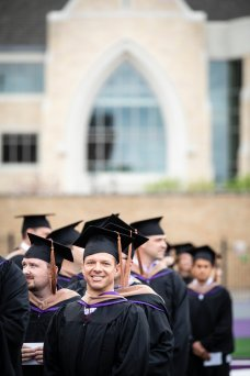 Students line up to receive their degrees during the 2018 Graduate Commencement ceremony in O'Shaughnessy Stadium on May 18, 2018 in St. Paul.