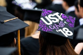 """A motarboard cap reads """"UST Class of '18"""" during the 2018 Undergraduate Commencement ceremony in O'Shaughnessy Stadium on May 18, 2018 in St. Paul."""