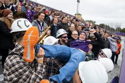 Students in Caruso's Crew celebrate a score during the homecoming game.