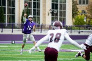 Jacques Perra makes a throw during the Homecoming game against Augsburg College.