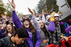 Student fans cheers from the sidelines during the Tommie Johnnie football game at Clemens Stadium in Collegeville on October 13, 2018. The University of St. Thomas fell to Saint John's University with a final score of 40-20.