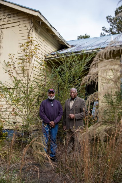 Steve Bullock, right, and his nephew Charles Bullock, 75, left, stand in front of the abandoned site of what used to be Eden Rosenwald Elementary School outside of their hometown of Enfield, North Carolina on November 23, 2018. One of few all-black schools in area growing up, this building is where Steve attended fourth, fifth and sixth grade. Steve Bullock was photographed for a feature story in St. Thomas Magazine.