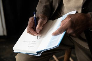 Steve Bullock signs a copy of his book for his nephew Charles Bullock, 75, in his hometown of Enfield, North Carolina on November 23, 2018. Steve Bullock was photographed for a feature story in St. Thomas Magazine.