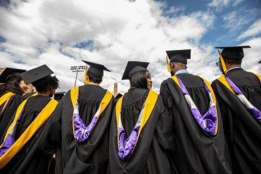 Students await the calling of their names during the 2019 Graduate Commencement Ceremony in O'Shaughnessy Stadium on May 25, 2019 in St. Paul.