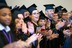 Dougherty Family College students applaud.