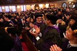 Students celebrate at the conclusion of the 2019 School of Law Commencement Ceremony at Westminster Presbyterian Church in Minneapolis on May 18, 2019.