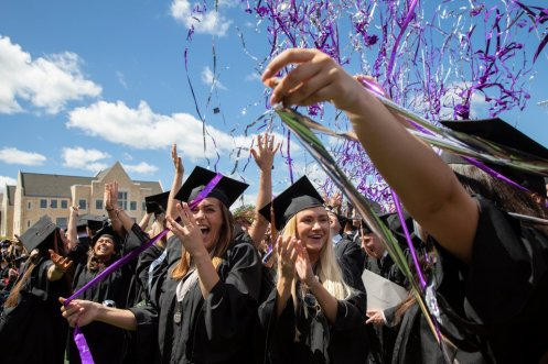 Confetti flies over the heads of students during the undergraduate ceremony on May 25.