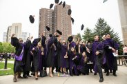LLM international students celebrate by throwing their caps in the air after the 2019 School of Law Commencement Ceremony at the School of Law Building in Minneapolis on May 18, 2019.