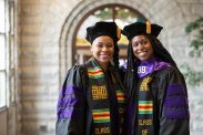 Two graduating students pose for a portrait during the 2019 School of Law Commencement Ceremony at Westminster Presbyterian Church in Minneapolis on May 18, 2019.