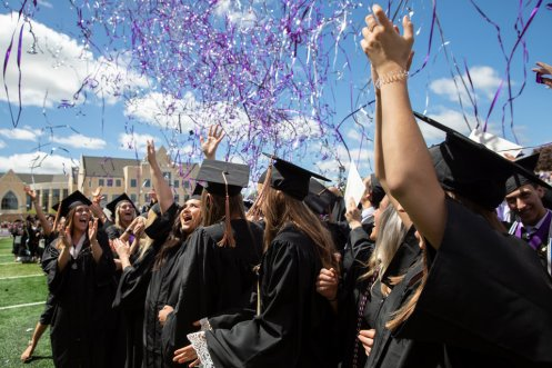 Graduates celebrate as confetti falls around them during the 2019 Undergraduate Commencement Ceremony in the O'Shaughnessy Stadium on May 25, 2019 in St. Paul.