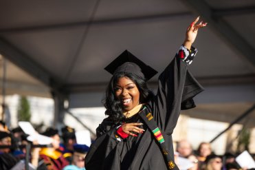 A student celebrates during the 2019 Graduate Commencement Ceremony in O'Shaughnessy Stadium on May 25, 2019 in St. Paul.