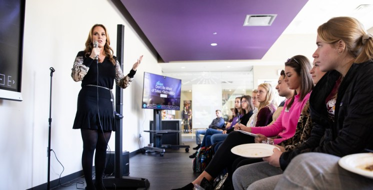 "Angelina Lawton, founder and CEO of Sportsdigita, speaks to a crowd of students who gathered in the Create Space at Anderson Student Center on October 16, 2018 as a part of the Schulze School of Entrepreneurship's ""Women Entrepreneurship Week""."
