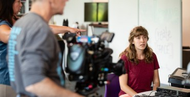 """Emily Meuer '18, participates in a Twin Cities Public Television (TPT) filming of a """"Sci Girls"""" episode in the create space in the Anderson Student Center on July 23, 2018 in St. Paul."""