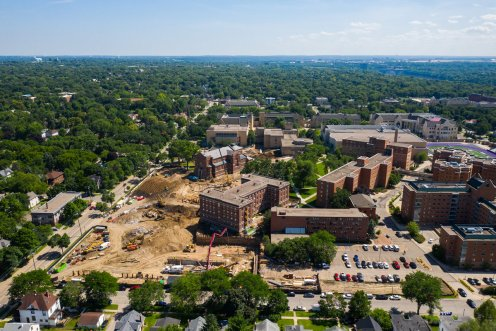 An aerial drone photo of the second-year residence hall, Iversen Center for Faith, and first-year residence hall projects surrounding the Chapel of St. Thomas Aquinas and Ireland Hall at the construction site on July 11, 2019, in St. Paul. (Mark Brown/University of St. Thomas)