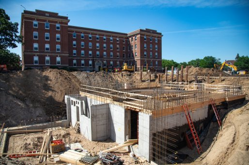 Construction crews work on the Iversen Center for Faith and first-year residence hall construction projects near Ireland Hall on July 11, 2019, in St. Paul. (Mark Brown/University of St. Thomas)