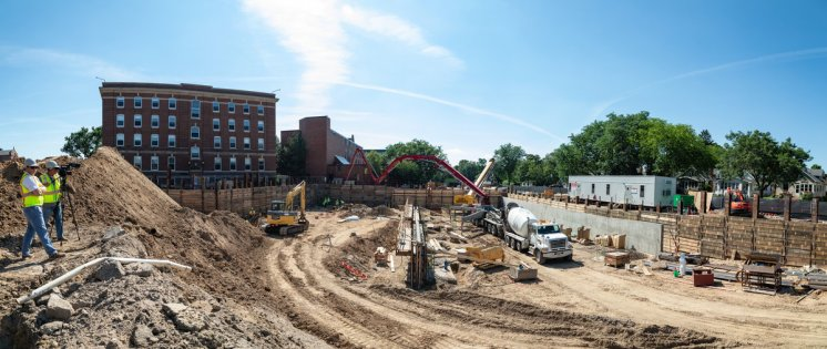 Construction crews work on the first-year residence hall project near Ireland Hall on July 11, 2019, in St. Paul. (Mark Brown/University of St. Thomas)