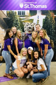 Members of Cadenza pose for a group photo with a Tommie cutout at the Minnesota State Fair on August 22, 2019 in St. Paul.