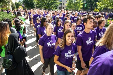 Students walk across the quad during the annual March through the Arches to celebrate the start of the school year and the arrival of a new class of freshmen on campus on September 3, 2019, in St. Paul.