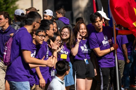 International students pose for a photo during the annual March through the Arches to celebrate the start of the school year and the arrival of a new class of freshmen on campus on September 3, 2019, in St. Paul.
