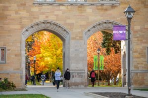 Students walk through the Arches on a beautiful fall day. Mark Brown/University of St. Thomas