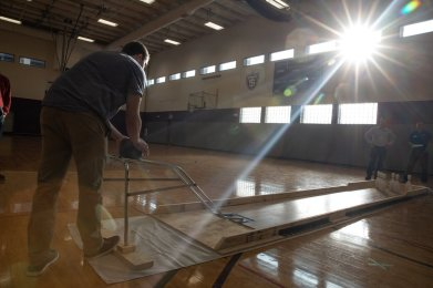 A student bowls during a concrete bowling competition between St. Thomas Civil Engineering students and students from other colleges in McCarthy Gym. Mark Brown/University of St. Thomas