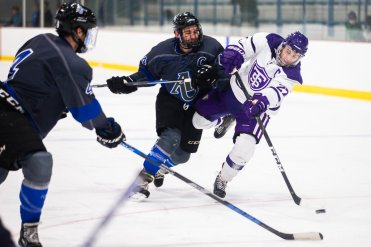 Brett Gravelle chases the puck during a game against Aurora University. Liam Doyle/University of St. Thomas