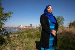Ikram Koliso stands for a portrait at Indian Mounds Park. Liam James Doyle/University of St. Thomas